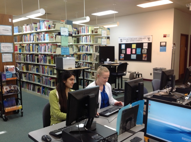 Students searching library resources at Touro College Bay Shore campus.