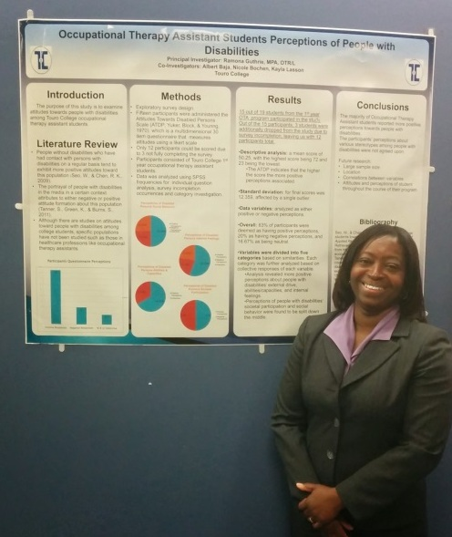 Occupational Therapy professor Ramona Guthrie stands in front of her poster