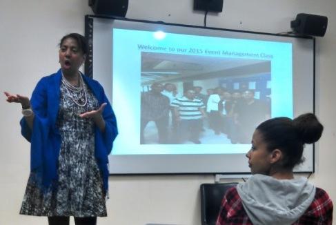 Professor Gena Bardwell introduces the program (Student Teresa Cadiz in the foreground)