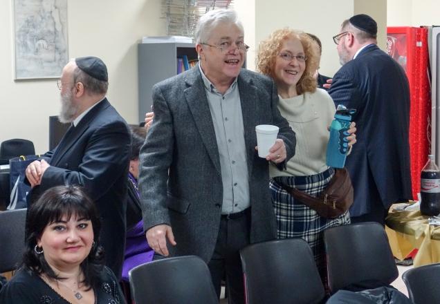 Dora Isakova, Boris Kocherga, and Carol Schapiro smile for the camera during lunch