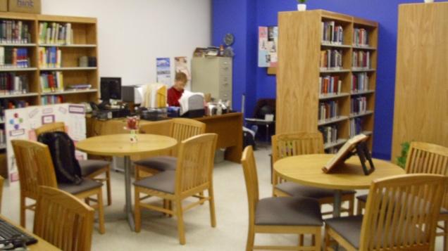 Librarian Rita Hilu awaits visiting students and professors