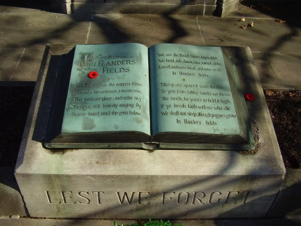 """Inscription of the complete poem in a bronze """"book"""" at the John McCrae memorial at his birthplace in Guelph, Ontario"""