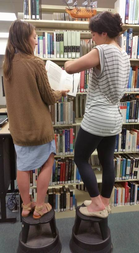 Inventorying goes to new heights at Bay Shore, featuring Librarian Rachel Oleaga and Library Assistant Katie Flood