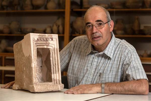 Yosef Garfinkel, an archaeologist at the Hebrew University of Jerusalem, shows off a stone shrine model that was found during excavations at Sha'arayim (aka Khirbet Qeiyafa), an ancient Israelite city believed to be one of King David's palaces and administrative centers, SW of Jerusalem. ©Hebrew University of Jerusalem