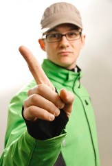 Man wagging his finger in disapproval