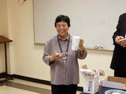 Liping Wang holds her present