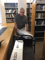 Library Assistant Boris Kocherga packing materials.