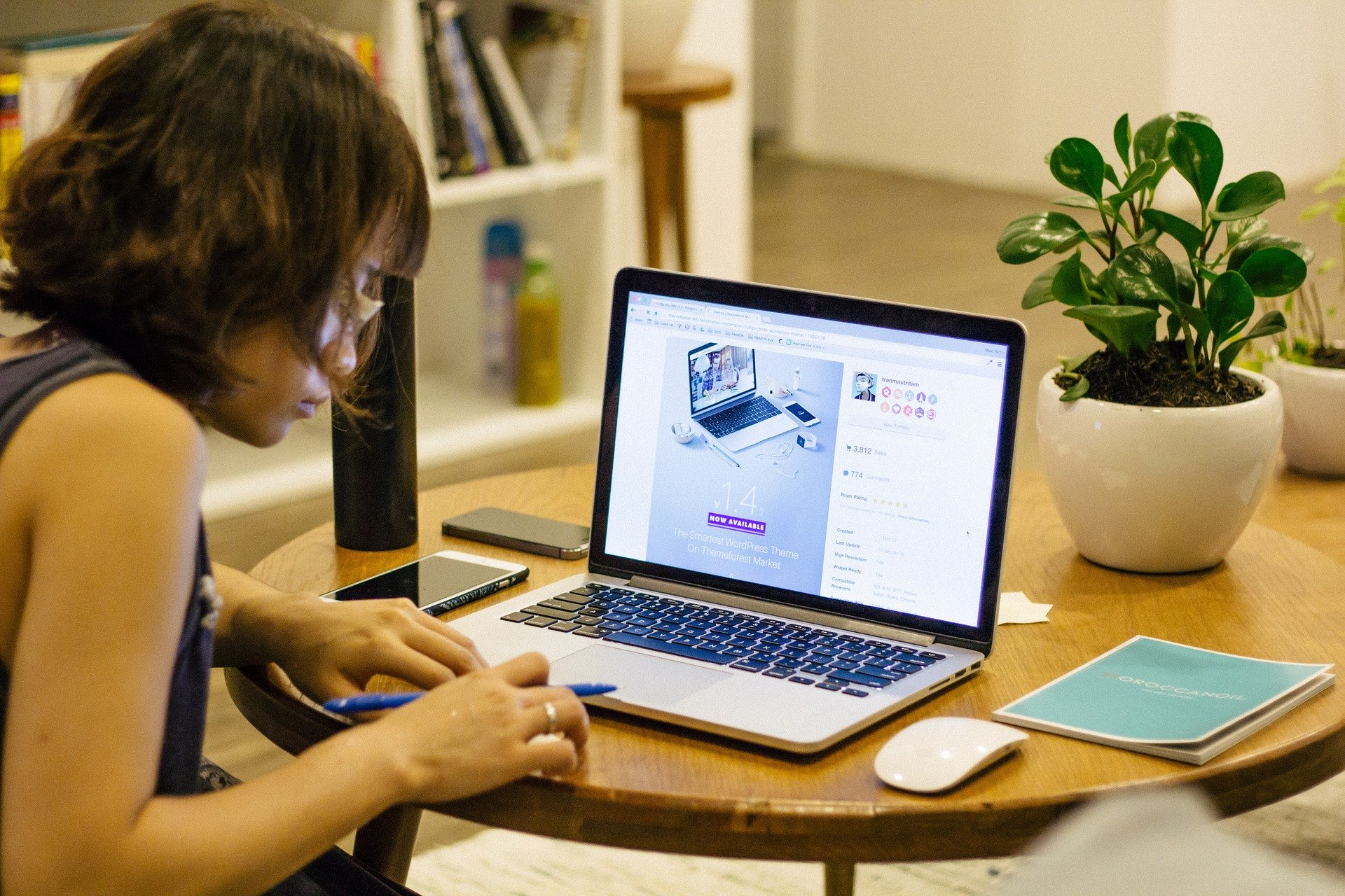 image of woman working on a laptop at a desk