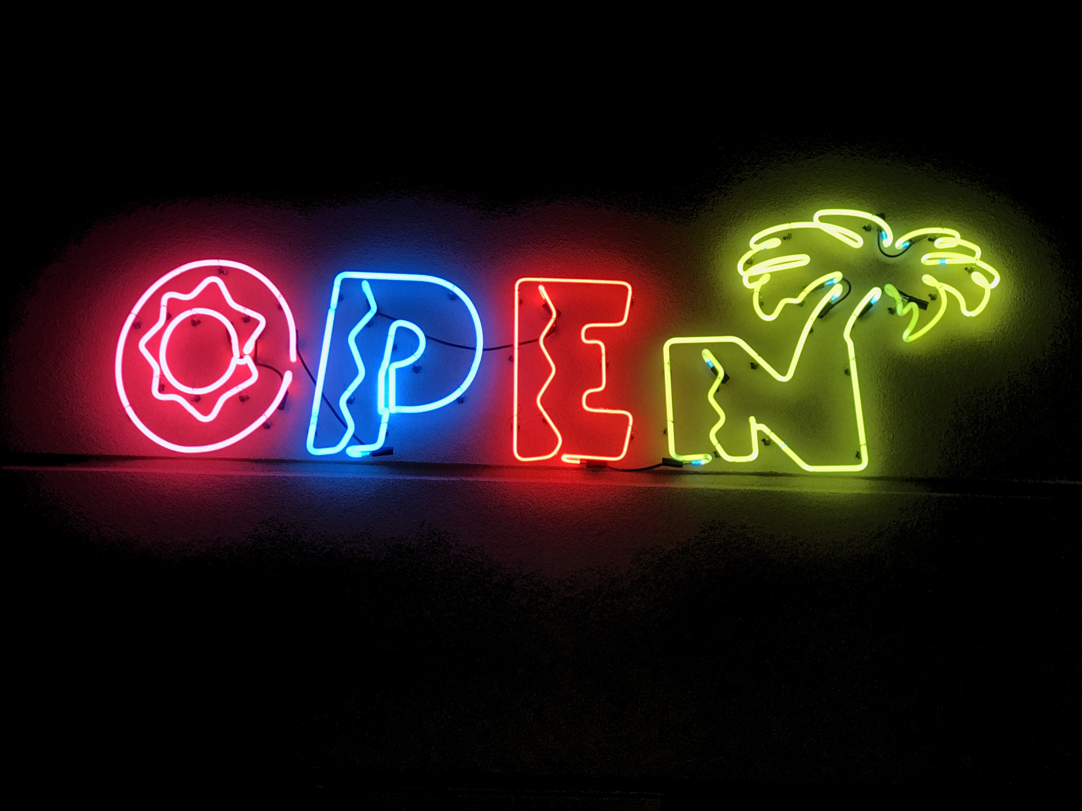 neon sign that says open