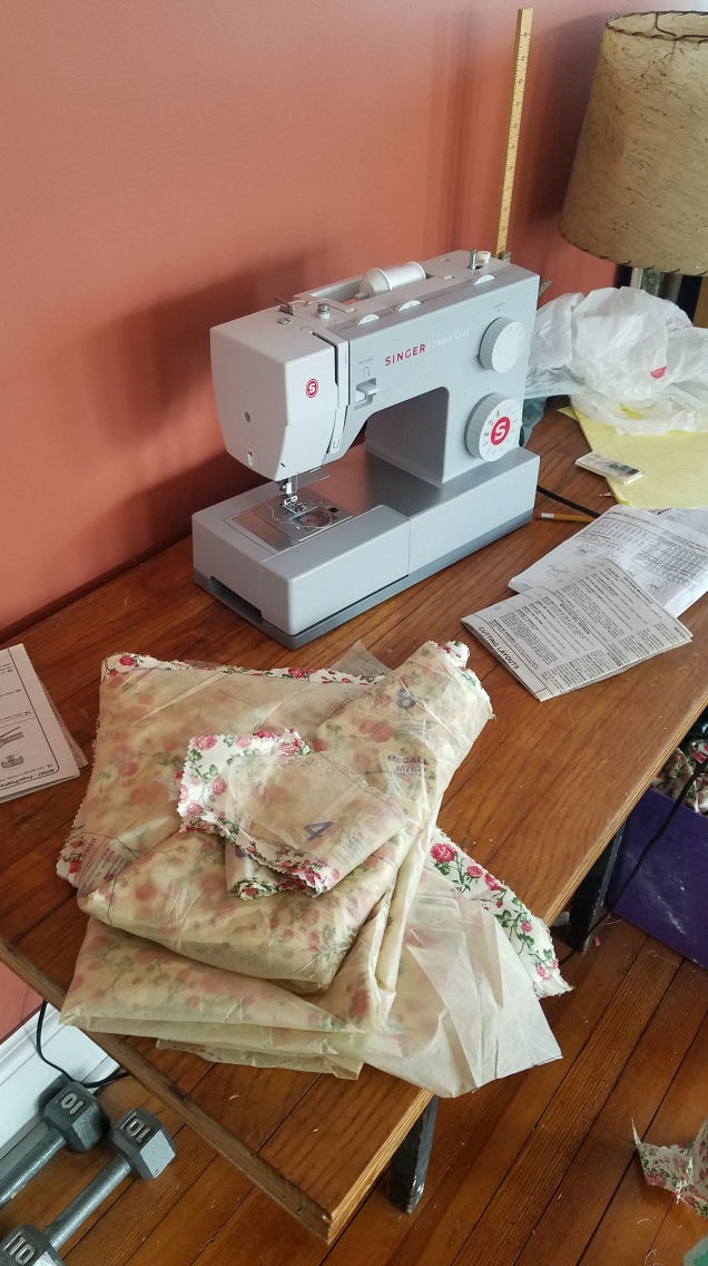 sewing machine next to cut fabric